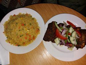 Fried rice with spare ribs and salade at African Kitchen Amsterdam